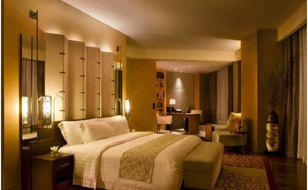 An image of a bed room with bright light at a luxury hotel - Shruti Sodhi Interior Designs
