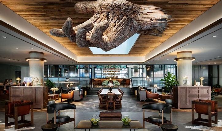 Sculptural artwork shown in hotel lobby area for unique interior view - Shruti Sodhi Interior Designs